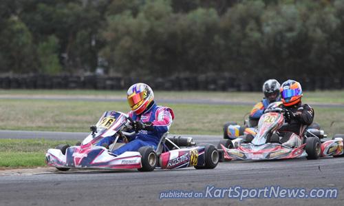 Ian Branson (#26) leading karting legend Remo Luciani (#20) in KA3 Masters