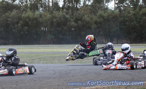 A first corner drama unfolds as karts scramble to avoid a stationary in turn 1 in Cadet 9. that's Annalise Ellis in the air.