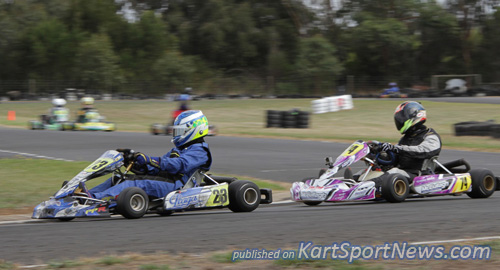Brayden Flood (#23) fending off Jimmy Mason (#74) for the lead in heat 1  in TAG Restricted Light