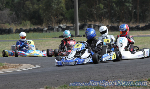 Bradley  Marsh-Stepney (#24) hot on the tail of Jordan Rae (#9) racing  in TAG 125 Light