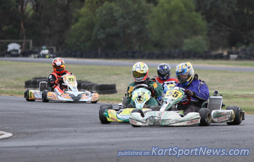 Andrew Stubbs (#55)  trying to hold off Steven Malkin (#12) in TAG 125 Restricted Masters