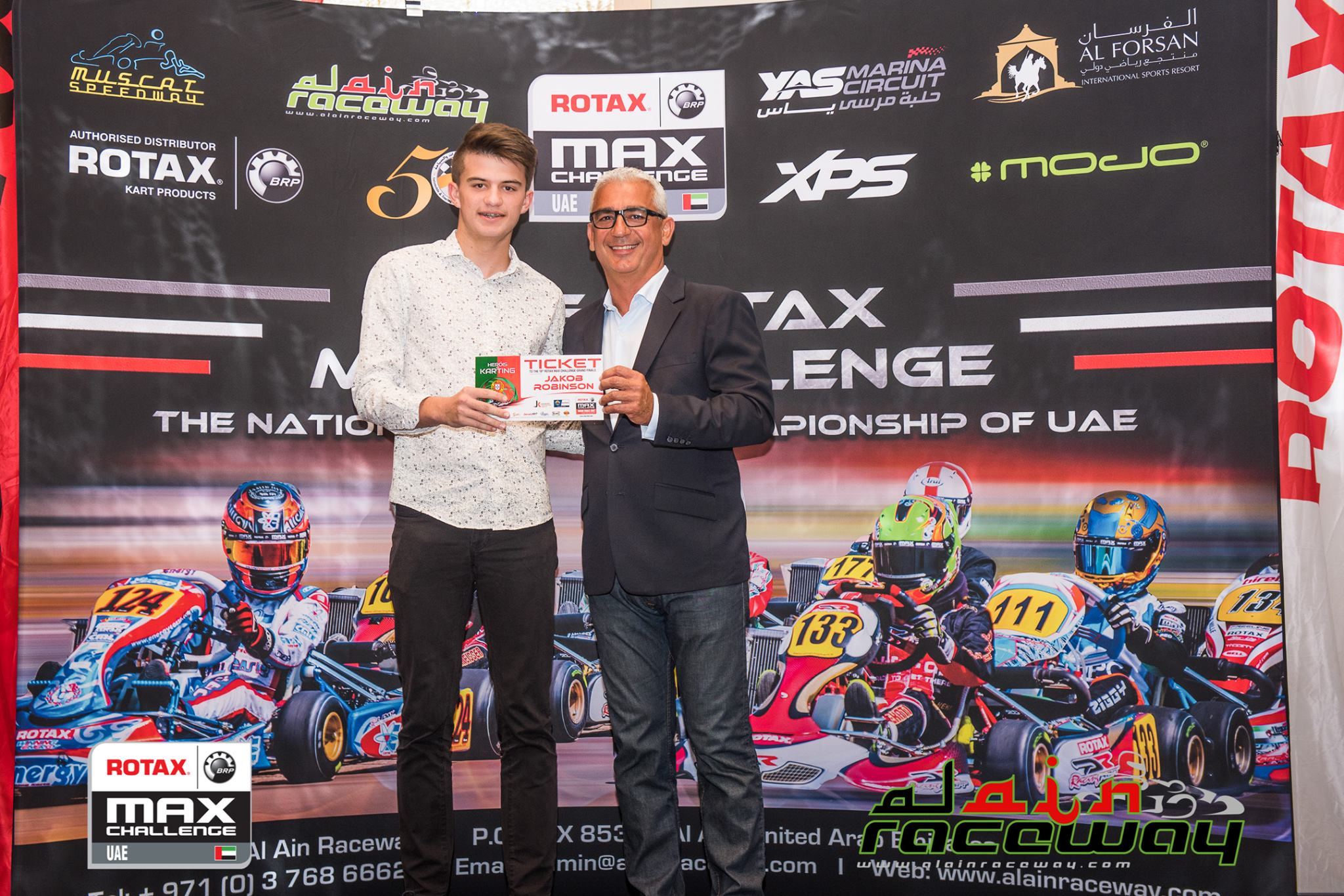 Jakob Robinson and his World Finals ticket (pic - Al Ain Raceway)