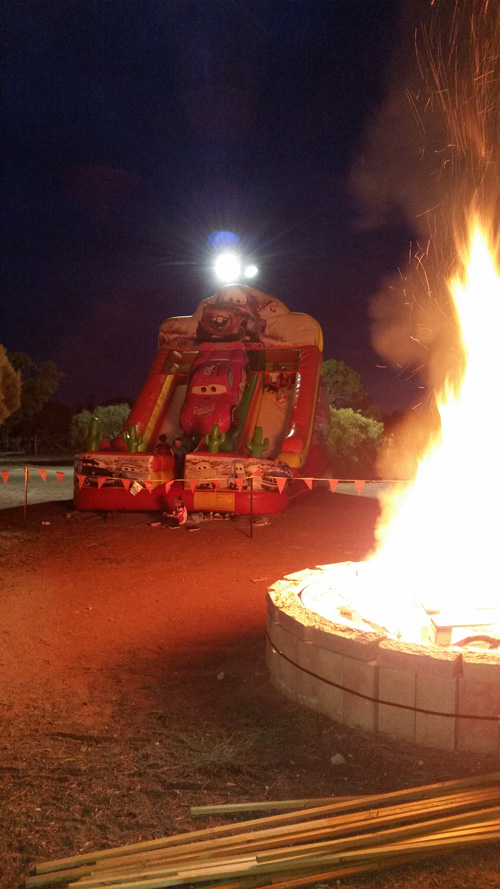 Saturday night entertainment - big bonfire and Lightning McQueen jumpy slide thingy