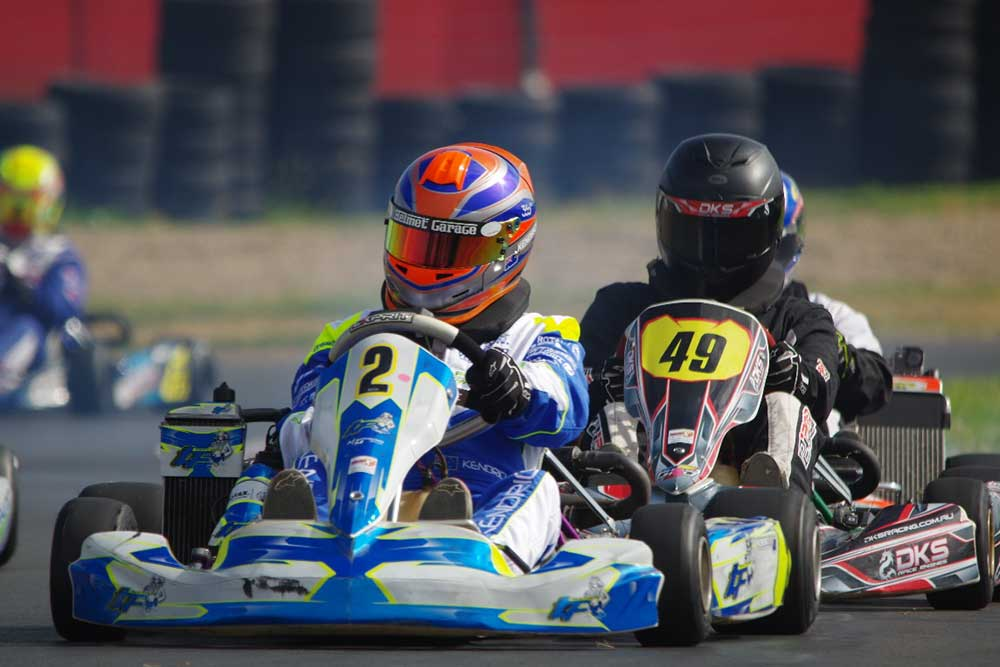 Simon Kendrick (#2) TaG Restricted Medium winner in the Troy Farley Race Engines team kart followed by Zach Phelan (#49). (pic - PamsPix)