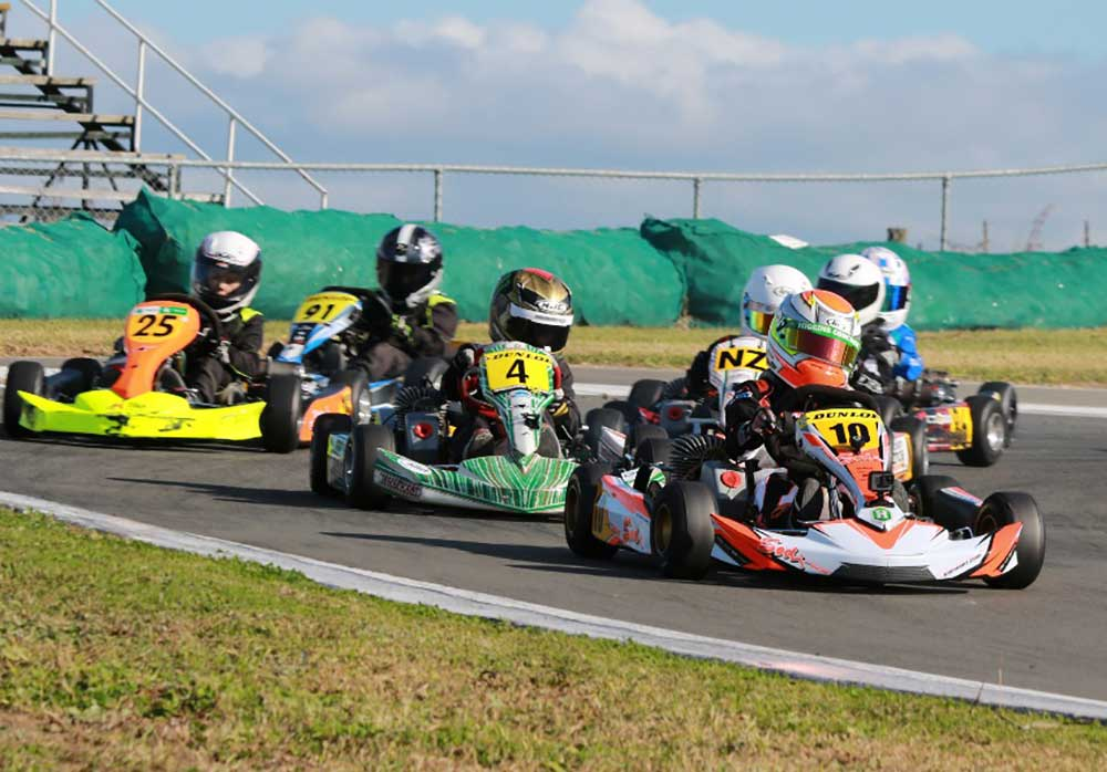 Emerson Vincent leads Thomas Bewley (#4) in a Cadet ROK class race