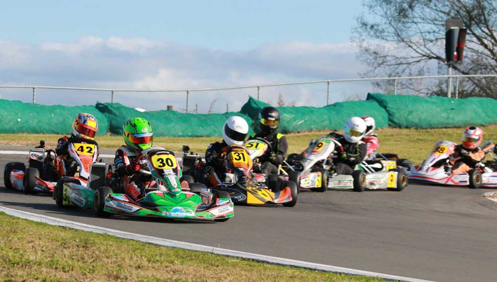 Goldstar class winner Jackson Rooney (#30) seen here leading Riley Jack (#31) and William Exton (#42) in a Junior Rotax Max heat