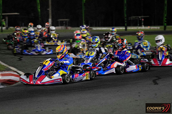 Pierce Lehane leads Cody Gillis (9), Ryan Wood (29) and the rest of the Rotax Light field (pic - Coopers Photography)